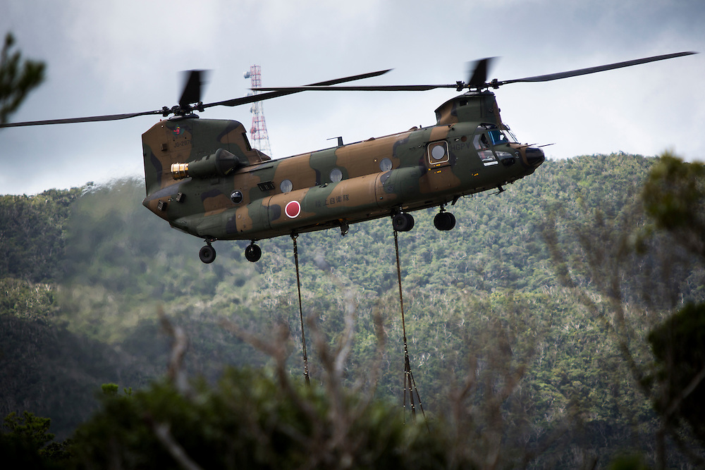 OKINAWA, JAPAN - SEPTEMBER 13 : Japan Air Self-Defense Force helicopter Boeing CH-47 is seen lifting a truck inside of the on going construction of helipads in restricted area of U.S. military's Northern Training Area in the village of Higashi, Okinawa Prefecture, Japan on September 13, 2016. Japanese government uses Japan Self-Defense Forces to help speed up the completion of total six helipads to be use by U.S Military. (Photo by Richard Atrero de Guzman/NURPhoto)