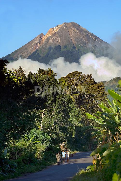 Flores, Mount Ebu Lobo, towers over a road east of Bajawa