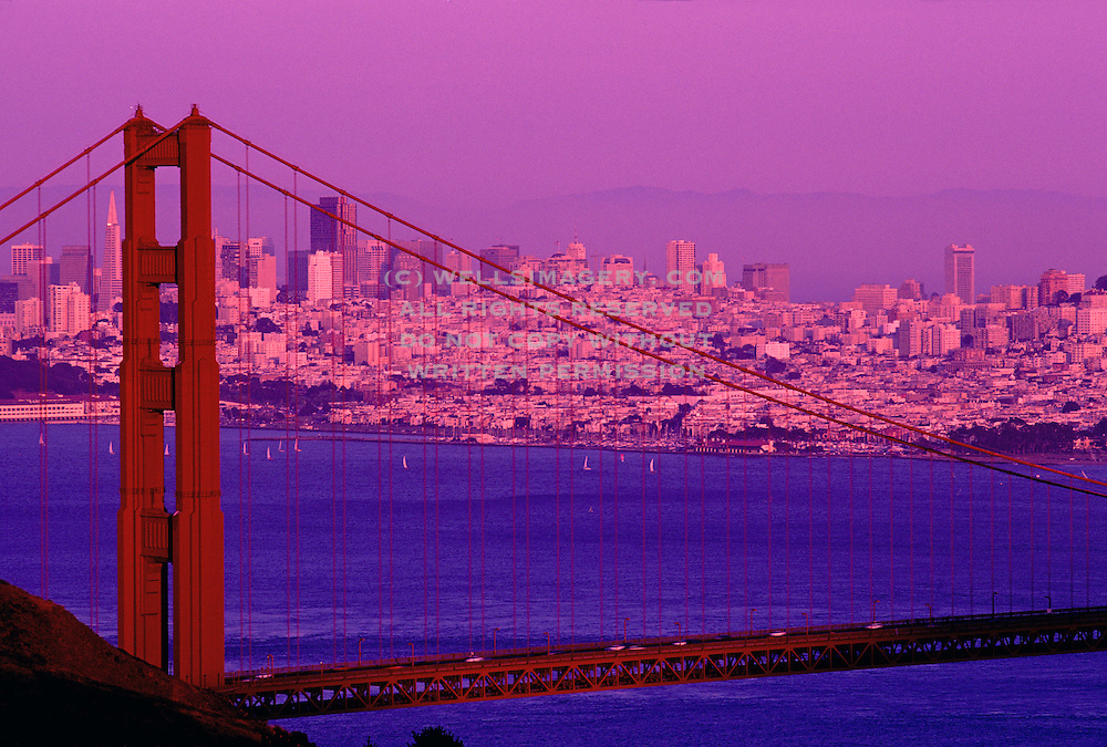 Image of Golden Gate Bridge in San Francisco, California with skyline and sailboats in bay
