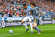 Karlan Grant of Huddersfield Town (16) and Caglar Soyuncu of Leicester City (4) in action during the Premier League match between Huddersfield Town and Leicester City at the John Smiths Stadium, Huddersfield, England on 6 April 2019.