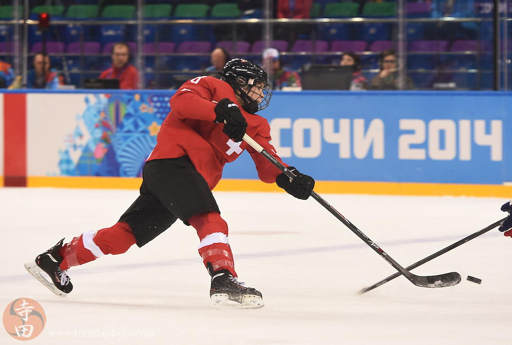 Feb 15, 2014; Sochi, RUSSIA; Switzerland forward Phoebe Stanz (88) shoots the puck in a women's quarterfinals ice hockey game during the Sochi 2014 Olympic Winter Games at Shayba Arena.