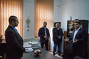 Roma activists Marian Daragiuin (right), Marius Tudor (left) and Negoi Mirel (Local Roma Councilor) at the office of mayor Manole Aurelian (left) at the town hall in Filipestii de Targ to which Marginenii de Jos belongs.