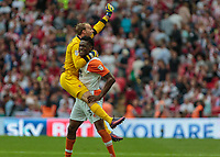 Football - 2017 Sky Bet [EFL] League Two Play-Off Final - Blackpool vs. Exeter City<br /> <br /> Sam Slocombe of Blackpool  jumps up on Armand Gnanduillet of Blackpool at the final whistle at Wembley.<br /> <br /> COLORSPORT/DANIEL BEARHAM