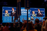 Hempstead, New York, USA. May 23, 2018. HILLARY CLINTON and Governor ANDREW CUOMO, with a bouquet of flowers for Clinton, speak on stage during Day 1 of New York State Democratic Convention, held at Hofstra University on Long Island. Clinton - the former First Lady, Secretary of State, and NYS Senator - endorsed the re-election of Gov. Cuomo for a third term.