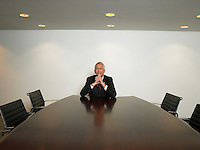 Businessman sitting alone in conference room