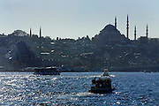 the silhouette of the Yeni Camii in Istanbul seen from the Sea of Marmara