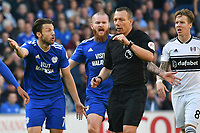 Football - 2018 / 2019 Premier League - Cardiff City vs. Fulham<br /> <br /> Harry Arter of Cardiff City &Aron Gunnarsson of Cardiff City protest to the referee Kevin Friend , at Cardiff City Stadium.<br /> <br /> COLORSPORT/WINSTON BYNORTH