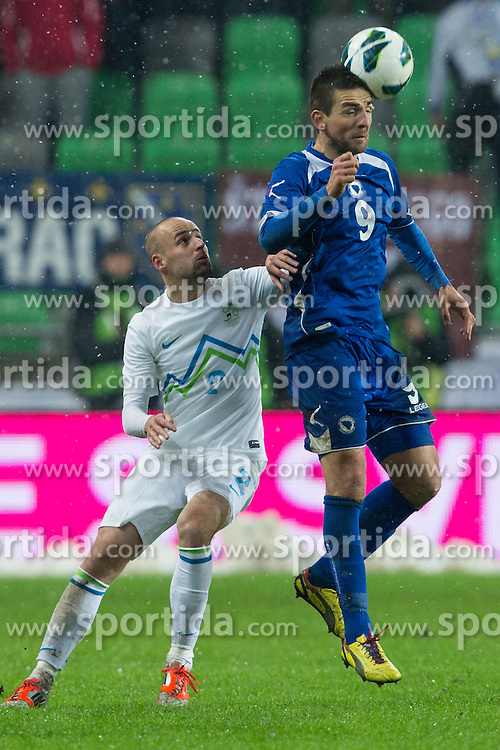 Miso Brecko and Vedad Ibisevic of Bosnia and Herzegovina during friendly football match between National teams of Slovenia and Bosnia and Herzegovina, on February 6, 2013 in SRC Stozice, Ljubljana, Slovenia. (Photo By Matic Klansek Velej / Sportida.com)