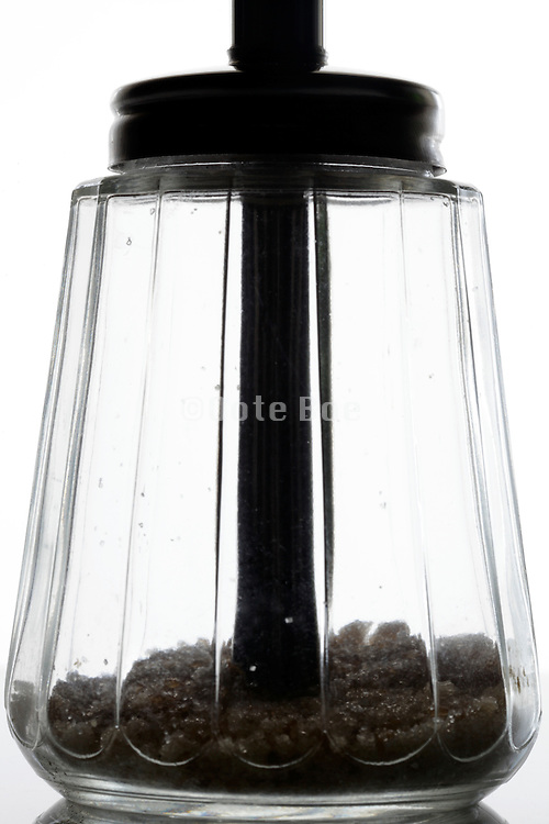 near empty sugar glass jar tradition old style measured dispenser