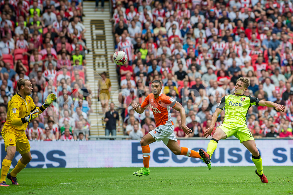 David Wheeler of Exeter City lobs Sam Slocombe of Blackpool to level the scores during the EFL Sky Bet League 2 Play-Off Final match between Blackpool and Exeter City at Wembley Stadium, London, England on 28 May 2017. Photo by Matthew Buchan.