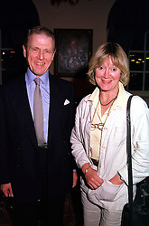 Actor EDWARD FOX and JOANNE DAVID, at a reception in London on 20th September 2000.OHD 107