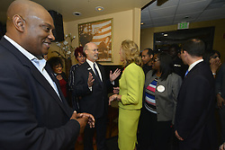 DWIGHT EVANS (Dem.), candidate for the 2nd Congressional District and PA Gov. TOM WOLF (Dem.) greet Candidate for U.S. Senate KATIE MCGINTY (Dem.) during the April 26, 2016 Election Day lunch with local Democratic Party leaders at Relish restaurant in the West Oak Lane section of Philadelphia, Pennsylvania.