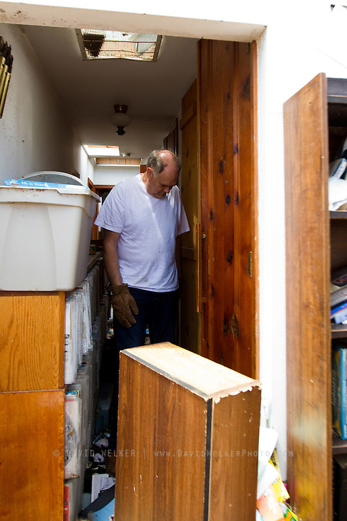May 25, 2011- Pastor Leon Stump from Joplin, Missouri looks in the closet where him and his wife Darlene waited out the tornado that decimated much of his neighborhood  on Sunday, May 22, 2011. Stump is the pastor of Victory Christian Center in Joplin. Credit: David Welker / TurfImages.com