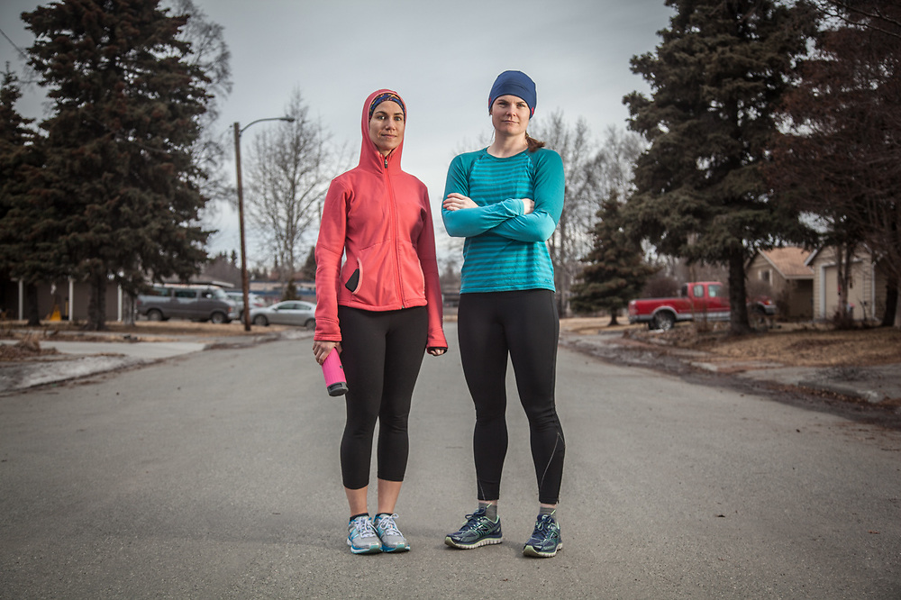 Attorneys Carina Uraiqat and Meghan Kelly preparing to run the Coastal Trail near Inlet View Elementary School, Anchorage.