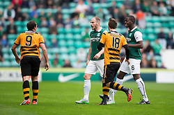 Alloa Athletic's Michael Chopra and Hibernian's David Gray have an disagrement and get booked.<br /> half time : Hibernian 1 v 0 Alloa Athletic, Scottish Championship game played 12/9/2015 at Easter Road.