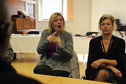 Woman signing at Mysight meeting