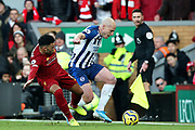 Liverpool midfielder Alex Oxlade-Chamberlain (15) tackles Brighton and Hove Albion midfielder Aaron Mooy (18) during the Premier League match between Liverpool and Brighton and Hove Albion at Anfield, Liverpool, England on 30 November 2019.