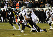 Dec 25, 2017; Philadelphia, PA, USA; Philadelphia Eagles defensive end Jake Long (56) sacks Raiders quarterback David Carr (4) during a NFL football game at Lincoln Financial Field. The Eagles defeated the Raiders 19-10. Photo by Reuben Canales