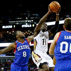 Nov 16, 2013; New Orleans, LA, USA; New Orleans Pelicans point guard Jrue Holiday (11) shoots over Philadelphia 76ers shooting guard Tony Wroten (8) during the second half of a game at New Orleans Arena. The Pelicans defeated the 76ers 135-98. Mandatory Credit: Derick E. Hingle-USA TODAY Sports