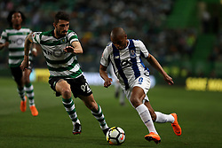 April 18, 2018 - Lisbon, Portugal - Porto's Algerian forward Yacine Brahimi (R 1) vies with Sporting's defender Cristiano Piccini from Italy during the Portugal Cup semifinal second leg football match Sporting CP vs FC Porto at the Alvalade stadium in Lisbon on April 18, 2018. (Credit Image: © Pedro Fiuza via ZUMA Wire)