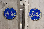Cycling sign on concrete barrier in City of London.