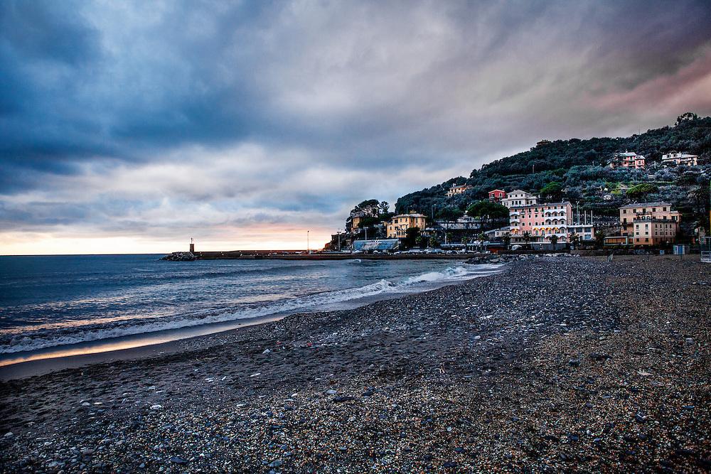 """A quiet beach or """"spiaggia"""" in Recco, Italy (Provincia di Genova). Early evening in March, 2013."""
