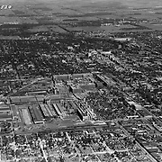 1927 aerial view of South Bend, Indiana, and the Studebaker plant.  This image faces north.  The University of Notre Dame is visible in the background.