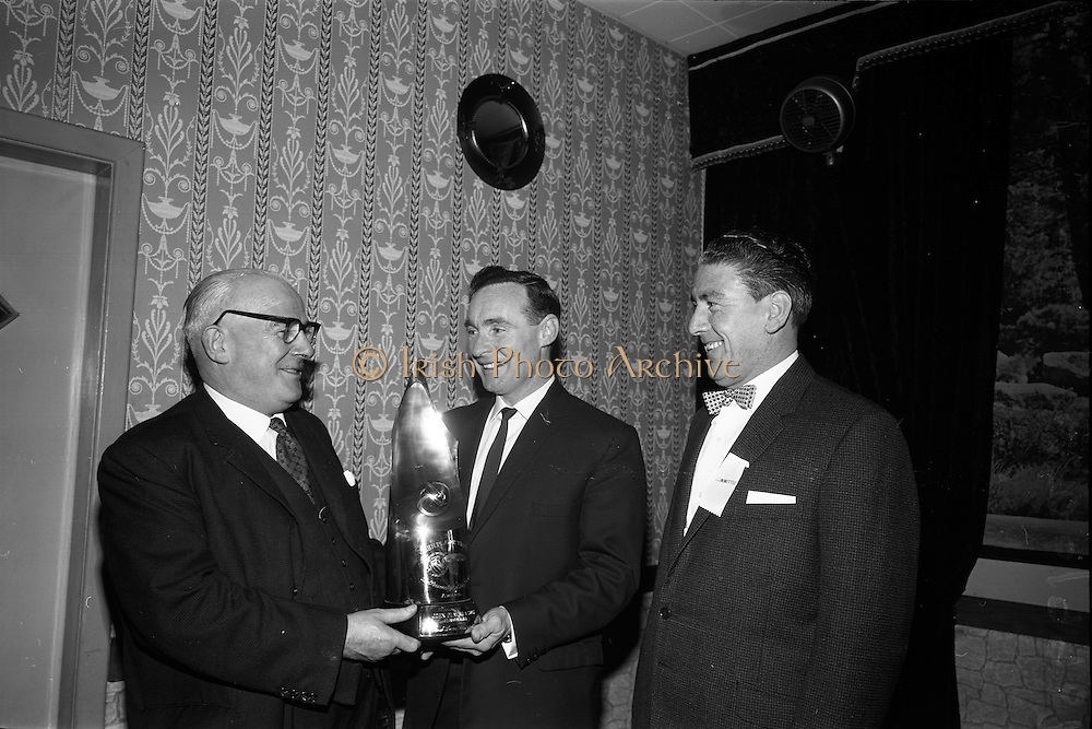 06/05/1965<br /> 05/06/1965<br /> 06 May 1965<br /> Soccer Writers Award presented at the Maples' Hotel, Dublin. Picture shows Mr E.K. Behave (left), Managing Director John Player and Sons, presenting the John Player trophy to Mr Sean Thomas, Coach to Bohemians F.C. who was chosen Soccer Personality of the Season by the Soccer Writers Association. Enright is Mr Eddie Boyle, President of the Association.