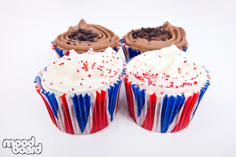 Various Union Jack cupcakes against white background