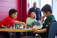 It was a nail biter for James Horan(WHES) as he waits for Sophia Moore's (ESS) move during the  Laconia City Wide Chess Tournament at the Huot Center Saturday morning.  (Karen Bobotas/for the Laconia Daily Sun)