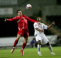 Photo: James Davies.<br />Swansea City v Swindon Town. Coca Cola League 1. 02/10/2007. <br />Swindon`s Lee Peacock controlls ball as Jason Scotland challenges.