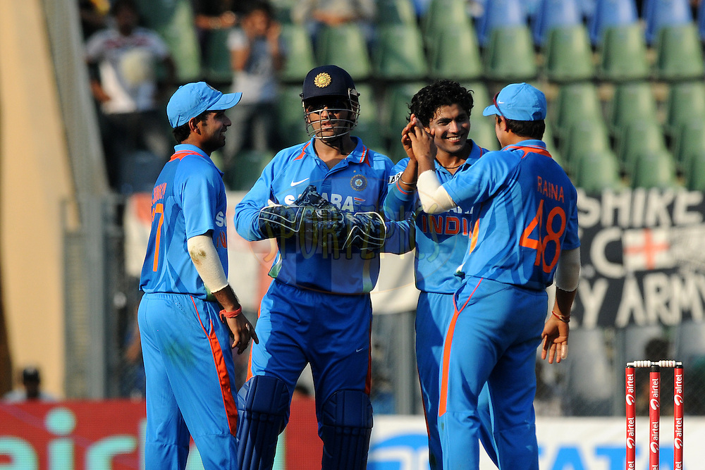 Ravindra Jadeja of India celebrates the wicket of Ravi Bopara of England during the 4th One Day International ( ODI ) match between India and England held at the Wankhede Stadium, Mumbai on the 23rd October 2011..Photo by Pal Pillai/BCCI/SPORTZPICS