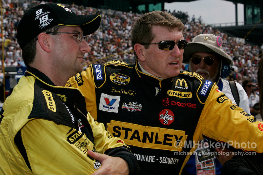 Bill Elliott talks to a crew member before the start of the Allstate 400 at the Brickyard Aug 7, 2005 in Indianapolis, IN.