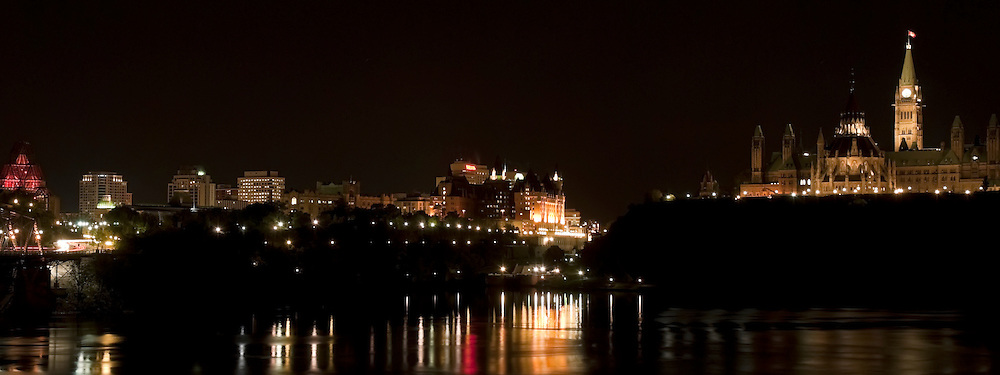 Nighttime view of Parliament Hill, Fairmont Chateau Laurier and the National Gallery of Canada.