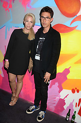 VICTORIA TANG and her brother EDWARD TANG at Club DNKY in celebration of #DKNYARTWORKS held at The Firestation, Lambeth High Street, London SE1 on 12th June 2013.