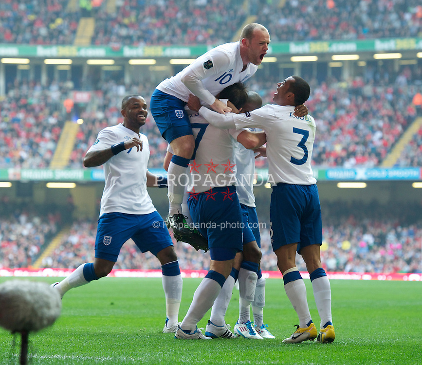 CARDIFF, WALES - Saturday, March 26, 2011: England's Frank Lampard celebrates scoring the opening goal from the penalty spot with team-mates Darren Bent, Wayne Rooney, Ashley Cole and Ashley Young during the UEFA Euro 2012 qualifying Group G match against Wales at the Millenium Stadium. (Photo by Chris Brunskill/Propaganda)