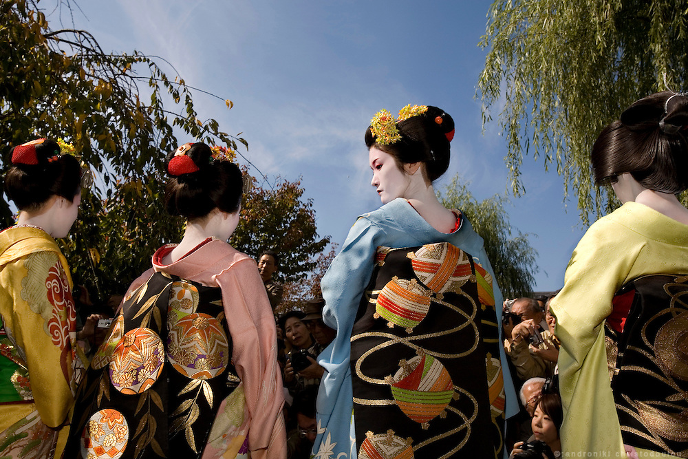 KYOTO-MAIKO .Memorial service for the poet Yoshii Isamu (1886-1960) who loved the Gion pleasure quarters. Geiko and maiko place flowers at a stone monument on which one of his poems is inscribed. Gion Shinbashi, just north of Shijo. Kyoto,.