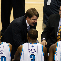 Mar 24, 2010; New Orleans, LA, USA; New Orleans Hornets lead assistant coach Tim Floyd and head coach Jeff Bower (top right) talk to players during a time during the second half against the Cleveland Cavaliers at the New Orleans Arena. The Cavaliers defeated the Hornets 105-92. Mandatory Credit: Derick E. Hingle-US PRESSWIRE