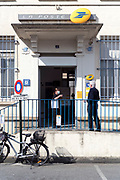 waiting to be let in at the postoffice during the Covid 19 crisis and lockdown France Limoux April 2020