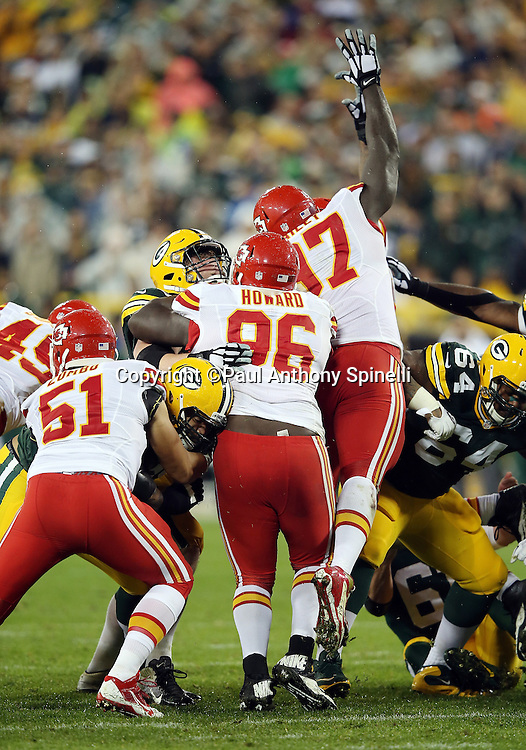 Kansas City Chiefs nose tackle Jaye Howard (96) pushes forward as Kansas City Chiefs defensive end Allen Bailey (97) leaps while trying to block a kick during the 2015 NFL week 3 regular season football game against the Green Bay Packers on Monday, Sept. 28, 2015 in Green Bay, Wis. The Packers won the game 38-28. (©Paul Anthony Spinelli)