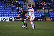 Carlisle United's Danny Redmond looks to go past Tranmere Rovers' Matthew Pennington. Skybet football league 1 match, Tranmere Rovers v Carlisle United at Prenton Park in Birkenhead, England on Saturday 29th March 2014.pic by Chris Stading, Andrew Orchard sports photography.