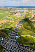 Nederland, Zuid-Holland, Gorinchem, 09-05-2013; knooppunt Gorinchem, kruising rijksweg A15 met de A27 (vlnr). Foto van  het klaverblad in oostelijke, langs de A15.<br /> Junction motorway A27 with A15, Cloverleaf Gorinchem.<br /> luchtfoto (toeslag op standard tarieven)<br /> aerial photo (additional fee required)<br /> copyright foto/photo Siebe Swart