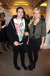 ADAM WAYMOUTH and OLYMPIA SCARRY at the annual Sotheby's Summer Party held at their auction rooms 34-35 New Bond Street, London W1 on 19th June 2008.<br />