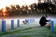 "The sun rises in the background as Bob Nolan spends a quiet moment visiting his wife Peggy at Fort Jackson National Military Cemetery. Nolan, a 79-year-old retired army veteran who served for 20 years 2 months and 22 days, visits Peggy every morning. Since she passed in 2007 Bob has only missed visiting his ""beautiful Southern Belle"" 21 days. Peggy is buried with his purple heart medal around her neck. ""I figured she gave me an extraordinary life, she deserves it,"" he said."