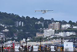 "© Licensed to London News Pictures.  03/06/2017; Torbay, Devon, UK. Torbay Airshow 2017. A CATALINA ""Flying Boat"" seaplane performs at the 2017 Torbay Airshow. The 2017 Torbay Airshow returns this weekend on Saturday 3 and Sunday 4 June with an action packed programme of world class air displays. The world's premier aerobatic team The Red Arrows will be debuting a new routine in the first display of their season, featuring their trademark combination of close formations and precision flying. The full display programme for the weekend begins on the Saturday between 2-3pm with The Tigers Freefall Parachute Display Team, Team Raven Aerobatic Display Team, the Percival Piston Provost and the Strikemaster. From 3-4pm will be the highly anticipated display by the Red Arrows, former British Female Aerobatic Champion Lauren Richardson in her Pitts Special S1-S and world aerobatic competitor Gerald Cooper in his Xtreme XA41. Finishing off the action packed afternoon from 4-5pm will see displays from the AutoGyro, the Battle of Britain Memorial Flight aircraft, the PBY5A Catalina seaplane, The Blades and the Royal Air Force's Typhoon FGR4. Sunday afternoon will see each of the aircraft take to the skies again before the weekend closes with a final display from the RAF Chinook team. The two day show, which had its inaugural event last year, takes place on Paignton Green with the Bay providing a stunning natural amphitheatre for viewing the air displays and the perfect location for a large coastal airshow event. To stay up to date with the latest Torbay Airshow news and updates follow @torbayairshow on Facebook, Twitter and Instagram or visit www.torbayairshow.com. Picture credit : Simon Chapman/LNP"
