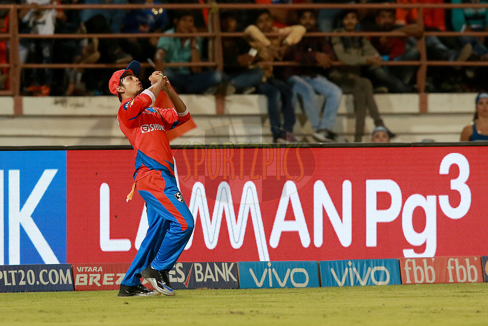 Ishan Kishan of GL takes a catch of Hardik Pandya of MI  during match 35 of the Vivo 2017 Indian Premier League between the Gujarat Lions and the Mumbai Indians  held at the Saurashtra Cricket Association Stadium in Rajkot, India on the 29th April 2017<br /> <br /> Photo by Rahul Gulati - Sportzpics - IPL