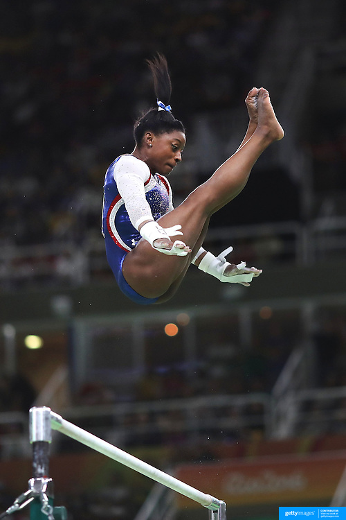 Gymnastics - Olympics: Day 6  Simone Biles of the United States performs her routine on the uneven bars during the Artistic Gymnastics Women's Individual All-Around Final at the Rio Olympic Arena on August 11, 2016 in Rio de Janeiro, Brazil. (Photo by Tim Clayton/Corbis via Getty Images)