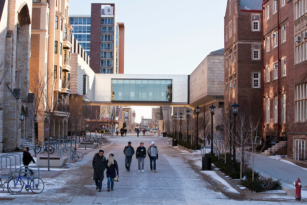 Pedestrians make their way along the East Campus Mall at the University of Wisconsin-Madison, passing the  Pres (cq) House on the left and The University Club on the right in Madison, Wis., Feb. 12, 2012. (Photo © Andy Manis)