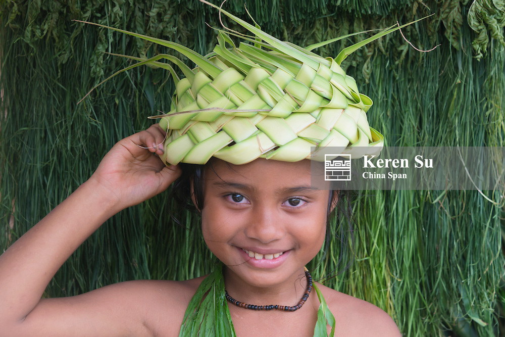 Yapese girl wearing hat made of banana leaves, Yap Island, Federated States of Micronesia