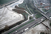 Nederland, A15, Sliedrecht, 17-10-2001; autosnelweg met viaduct spoorlijn Dordrecht-Geldermalsen; rechtsonder contructie nieuwe aansluiting snelweg; rechtsboven industrieterrein Wijngaarden, zand linksboven wordt slib en gronddepot voor Betuweroute, de spoorlijn zelf komt langs de uiterste rand (linskboven) te lopen<br /> luchtfoto (toeslag), aerial photo (additional fee)<br /> photo/foto Siebe Swart